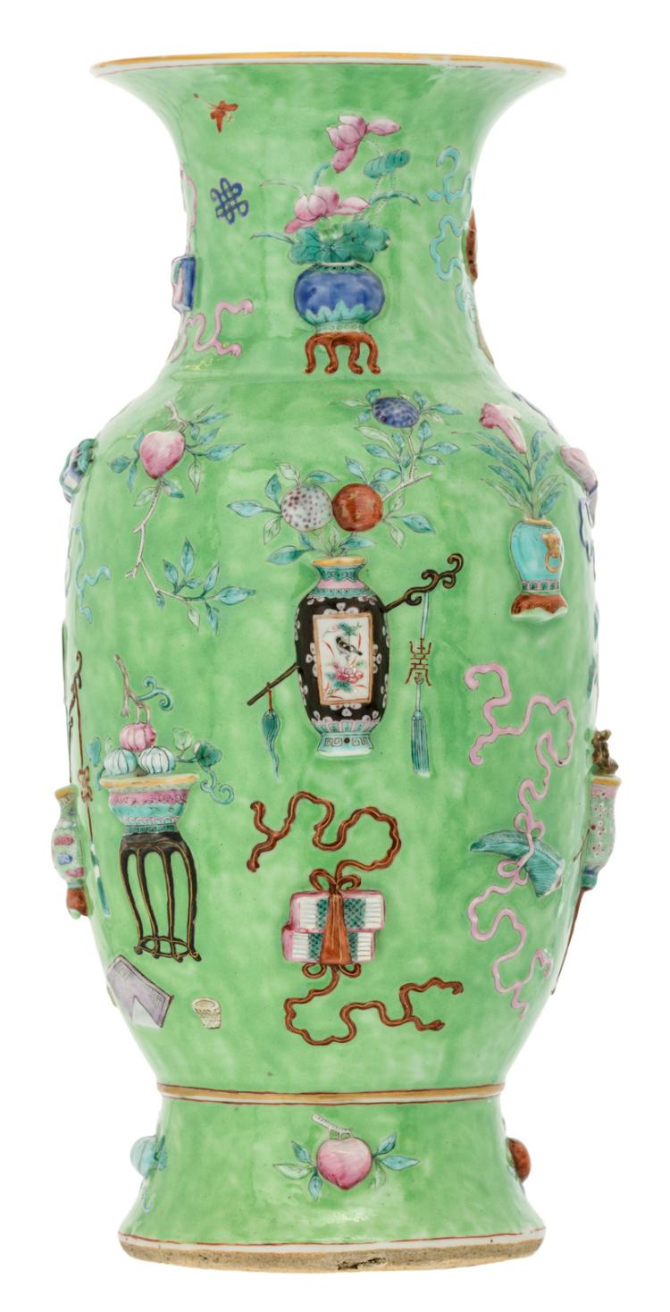 A Chinese green ground famille rose relief moulded vase with antiquities and auspicious symbols, H 44,5 cm