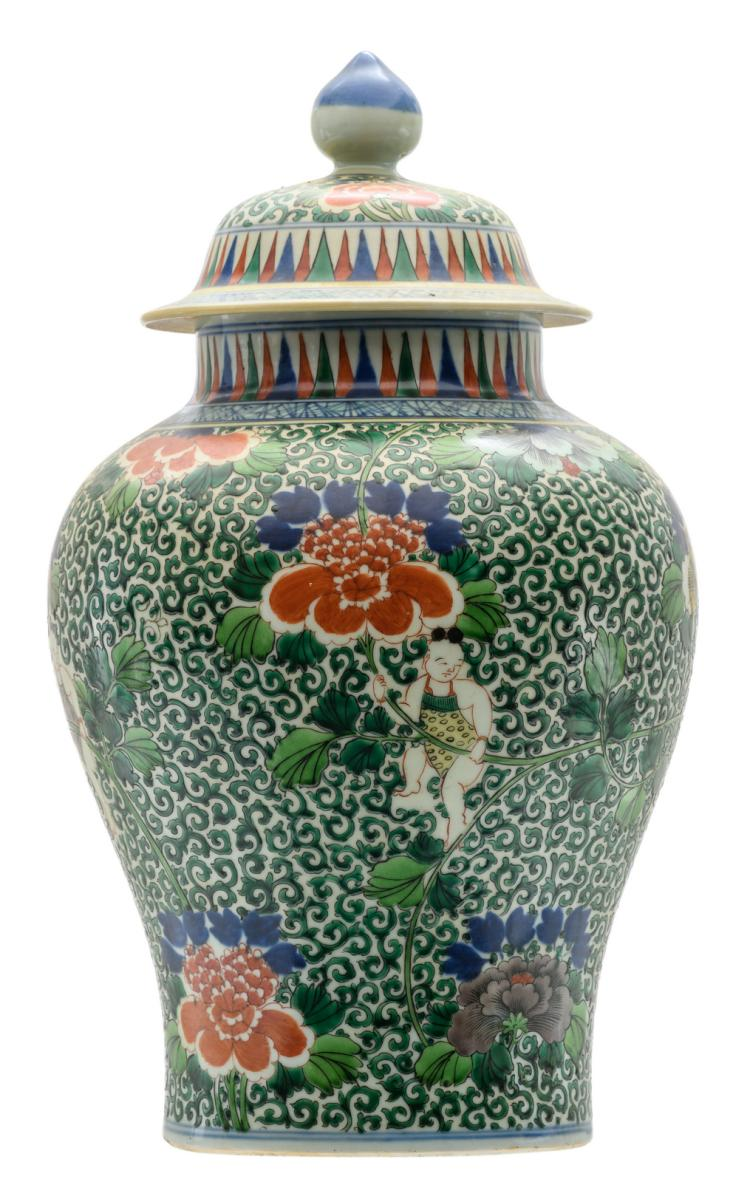 A Chinese famille verte floral decorated vase and cover with youngsters and flower branches, with a Wanli mark, H 44 cm