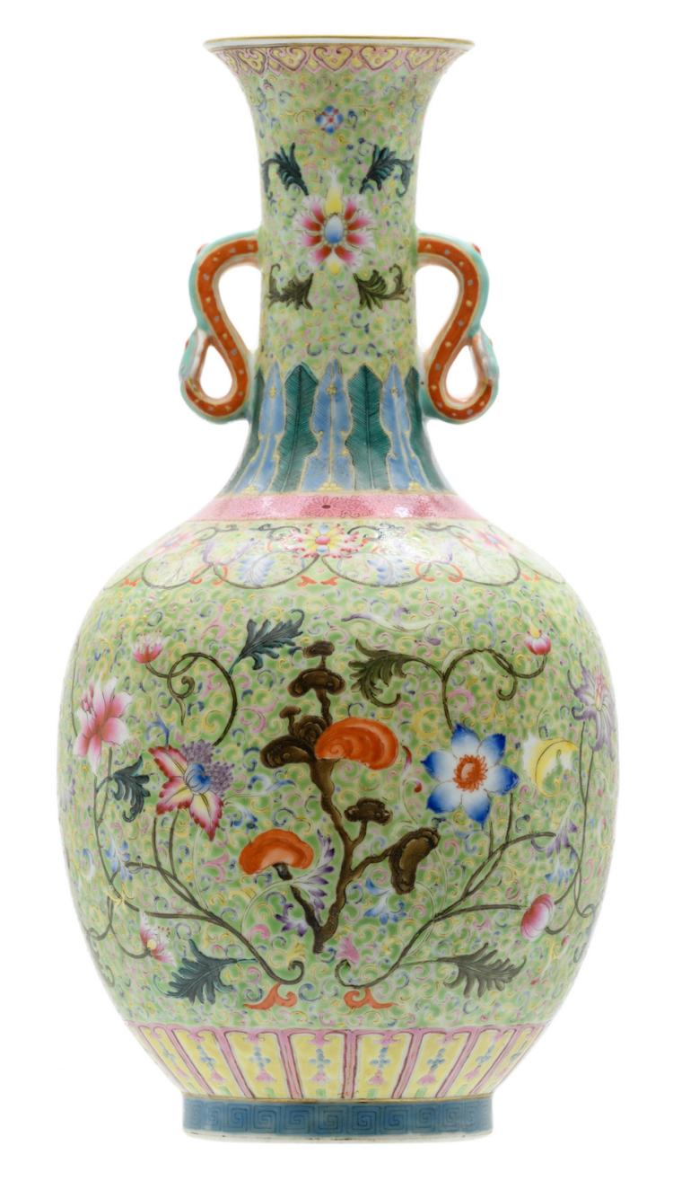 A Chinese green ground famille rose floral decorated bottle vase with flower branches and fungi, the handles ruyi shaped, Daoguang marked,H 33 cm