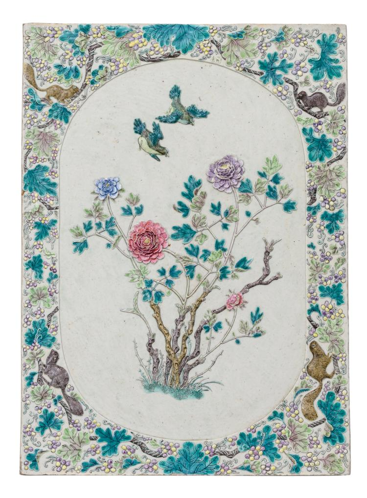 A fine Chinese polychrome and relief decorated glazed biscuit plaque with squirrels and vine trendrils, the roundels with birds and flower branches,32 x 44 cm