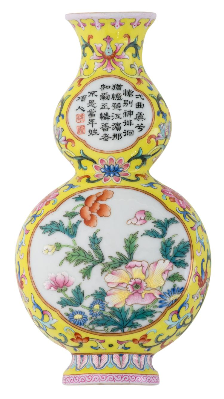 A Chinese yellow ground famille rose floral decorated double gourd wall vase, the roundels with flower branches and a calligraphic text, with a Qianlong mark, H 16 cm