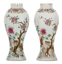 Two Chinese famille rose baluster shaped vases, decorated with a rock, flower branches and a butterfly, with silver mount, 18thC, H 25 cm