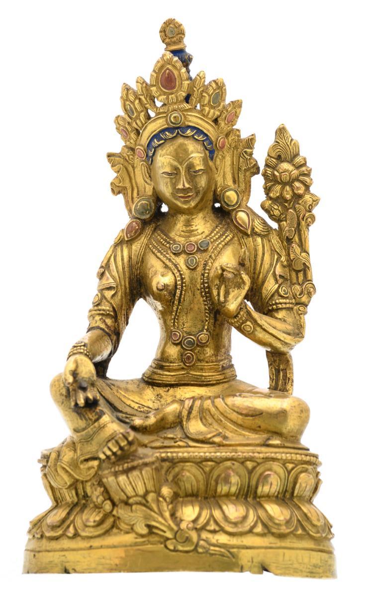 A Sino-Tibetan gilt bronze seated Buddha with traces of polychromy, H 18 cm