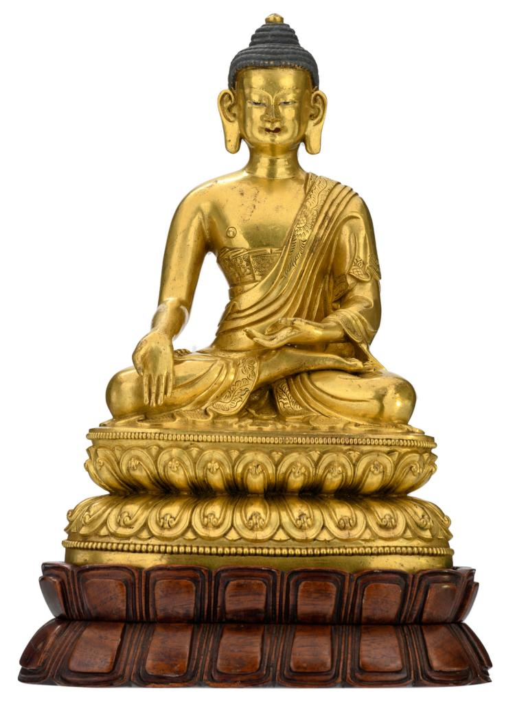 A Chinese gilt bronze seated Buddha with traces of polychromy, on a matching sculptured hardwood stand, H 28,5 (without base) - 33,5 cm (with base)