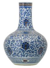 A fine Chinese blue and white and copper red glazed bottle vase, overall decorated with lotus flowers and the eight auspicious Buddhist symbols, Qianlong marked, 19thC, H 54 cm