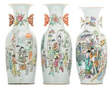 Three Chinese famille rose and polychrome decorated vases, one side with an animated scene, the other side with flower branches and a calligraphic text, H57 - 60 cm