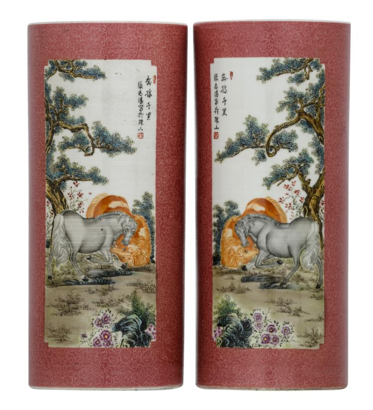 A pair of Chinese pink ground floral incised cylindrical vases, the roundels polychrome decorated with horses, marked, H 28,5 cm