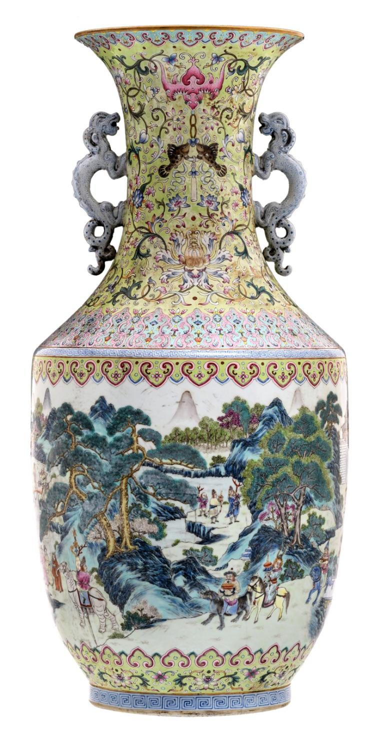 A large Chinese famille rose and polychrome floral overall decorated vase with animated scenes in a mountainous river landscape, the handles dragon shaped, with a Qianlong mark, H 76 cm