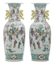 A pair of Chinese famille rose vases, decorated with an animated scene in and around a garden pavillion, 19thC, H 61,5 cm