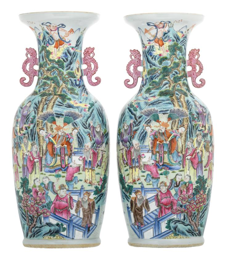 A pair of Chinese famille rose overall decorated vases with Immortals in their habitat, the handles dragon shaped,H 63,5 - 64,5 cm