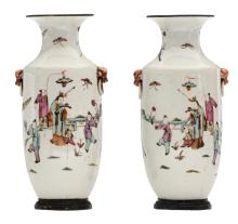 A pair of Chinese famille rose vases, overall decorated with an animated scene, with silver mounts, 19thC, H 27,5 cm