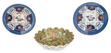 A Chinese famille rose and gilt decorated lotus shaped Canton plate with birds, butterflies and flower branches, 19thC; added two Imari decorated dishes, 18thC, H 3,5 - 6,5 - ø 22,5 - 26 cm
