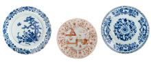 Two Chinese blue and white floral decorated plates, 18thC; added a Chinese iron red and gilt decorated plate depicting figures in a garden, 18thC, ø 28 - 35 cm