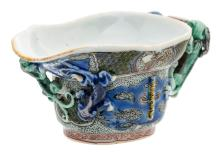 A so-called Chinese famille verte relief decorated 'libation cup', Kangxi and period, H 4,8 cm- W 11,2 cm