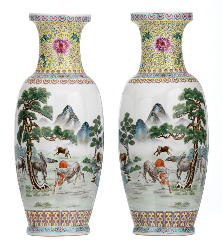 A pair of Chinese polychrome decorated vases with horses in a mountainous river landscape and a calligraphic text, marked, H 63 - 63,5 cm