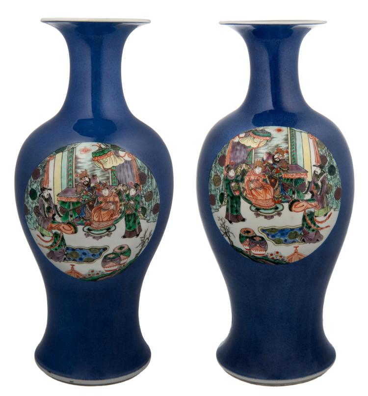 A pair of Chinese bleu poudré baluster shaped vases, the roundels famille verte, decorated with an animated scene and a pheasant on a rock with flower branches, signed by the artist, H 45 cm