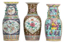 Three Chinese polychrome famille rose floral decorated vases, the roundels with flower branches, court scenes and antiquities, 19th and 20thC, H 44 - 46 cm