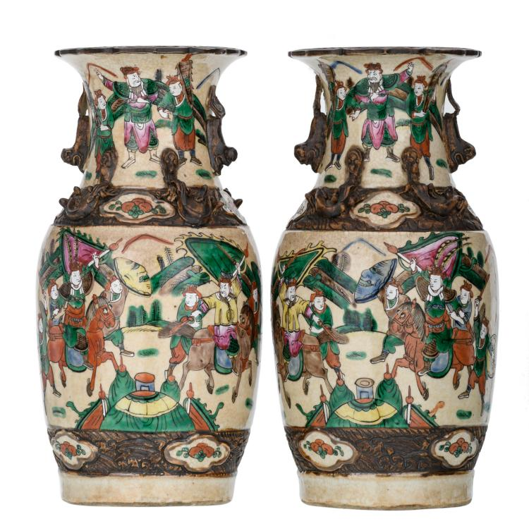 A pair of Chinese stoneware vases, overall polychrome decorated with warriors, marked, about 1900, H 36 cm