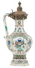 A Chinese export porcelain famille verte decorated puzzle jug and cover, Kangxi and period, the gilt silver mount probably German, H 26 cm