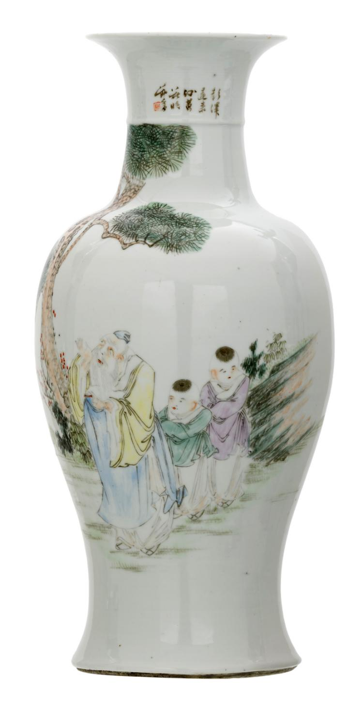 A Chinese baluster shaped vase, polychrome decorated with scholars in a landscape and a calligraphic text, marked, H 45,5 cm