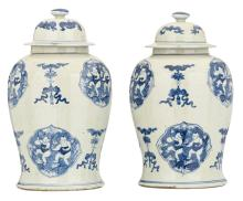 A pair of Chinese blue and white decorated vases and covers with auspicious symbols, the roundels with Héhe twins, H 45,5 - 46 cm