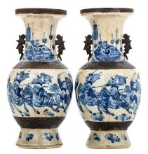 Two Chinese baluster shaped stoneware vases, blue and white decorated with warriors, marked, about 1900, H 46,5 cm