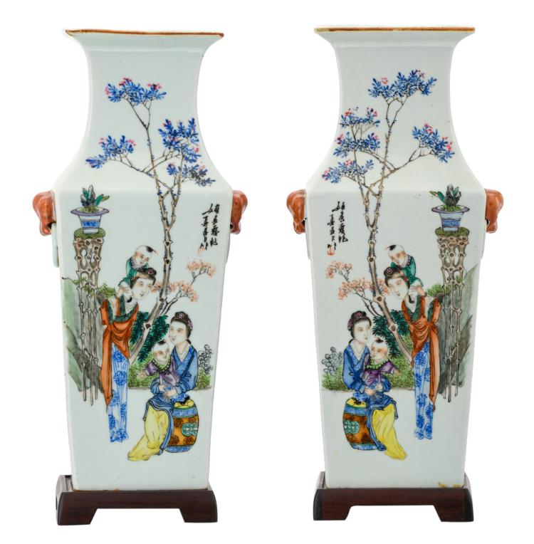 A pair of Chinese quadrangular polychrome decorated vases with animated scenes and calligraphic texts, signed, on matching wooden bases, H 40 (without base) - 42,5 cm (with base)