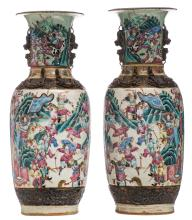 A pair of Chinese famille rose stoneware vases, overall decorated with a battle scene, marked, about 1900, H 60,5 - 61,5 cm