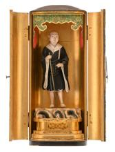 A lacquered Japanese shrine with engraved brass mounts, inside a polychrome decorated figure of a monk, Meiji and period,H 34,5 - W 14,5 - D 11 cm