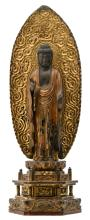 A Japanese sculpted gilt lacquered wooden Buddha on a ditto stand and a 'Fuma-goko' aureole, Edo period,H 64 - W 23 - D 16 cm