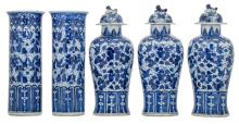 A five-piece Chinese blue and white decorated garniture with butterflies and flower branches, Kangxi marked, H 25,5 - 27,5 cm