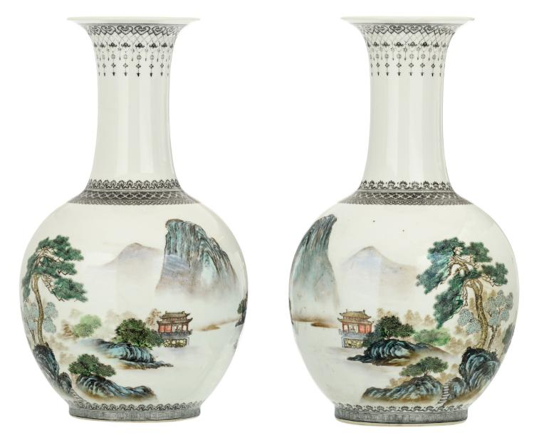 A pair of Chinese polychrome decorated bottle vases with figures and pavillions in a mountainous river landscape and calligraphic texts, marked, H 42,5 - 43,5 cm