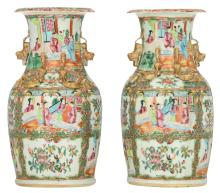A pair of Chinese Canton famille rose floral decorated vases, the roundels with court scenes, H 36,5 cm