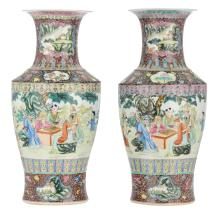 Two Chinese famille rose and polychrome floral decorated vases with figures in a garden, with a Qianlong mark, H 56 cm