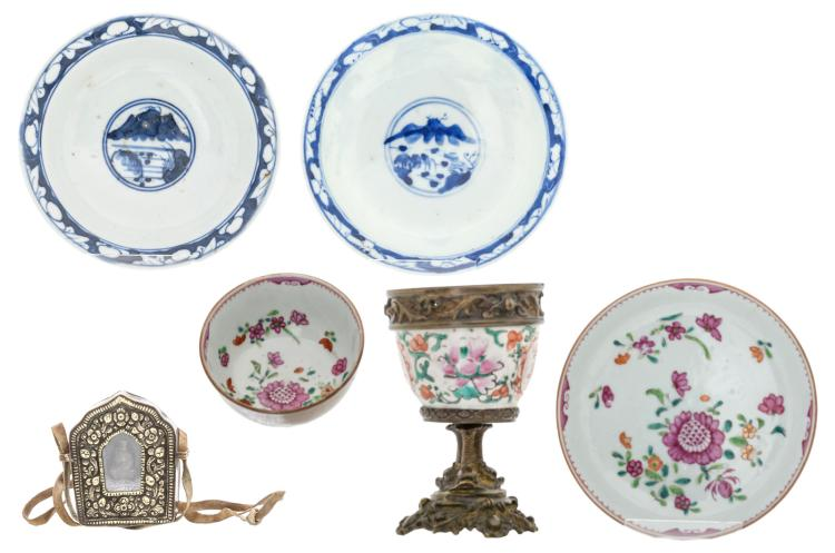 A Chinese blue and white and famille rose floral decorated cup and saucer, two footed plates and a cup with bronze mount, 18th and 19thC; added a Tibetan silver and copper miniature shrine with a Buddha statue, 19th C, H 3,5 - 13 - ø 8 - 14,5 cm
