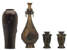 A Japanese patinated and relief decorated bronze vase with fish, marked; added a pair of ditto miniature vases; extra added a Chinese bronze bottle vase, the roundels and the handles open work and dragon relief decorated with inlay, with a Qianlong mark, H 13 - 42 cm