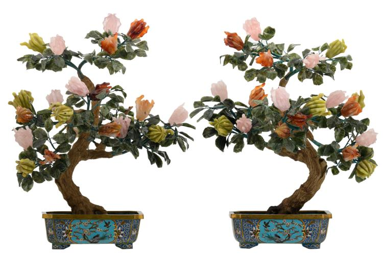 A fine pair of Chinese decorative trees with semi-precious stones in a floral decorated cloisonné jardiniere, the roundels with a bird, a rock and flower branches, H 60 - 65 - W 52 - 53 - D 40 - 42 cm