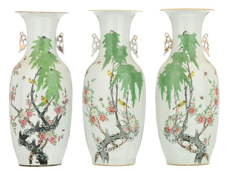 A pair of Chinese famille rose decorated vases with birds on flower branches and butterflies; added a ditto vase, H 57,5 - 58,5 cm
