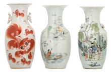 Two Chinese famille rose decorated vases with an animated scene, figures, a dog in a garden and calligraphic texts; added a ditto iron red decorated vase with Fu lions, H 42 - 43 cm