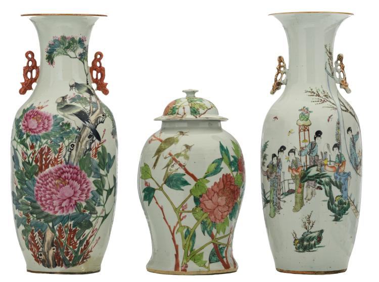 A Chinese famille rose decorated vase and vase and cover with birds, flower branches and calligraphic texts; added a ditto polychrome decorated vase with a gallant garden scene, H 41,5 - 58 cm