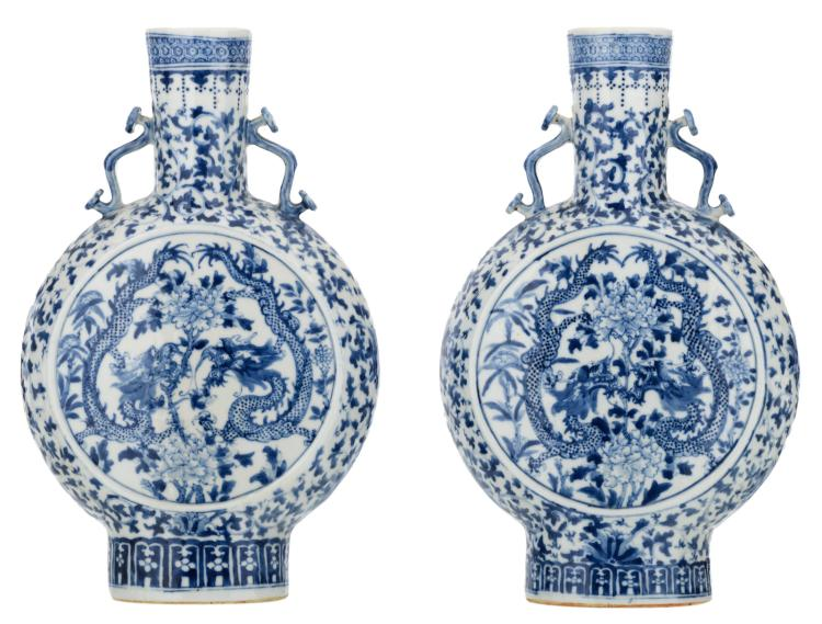 A pair of Chinese blue and white floral decorated moon flasks with dragons and flower branches, the handles ruyi shaped, H 35 cm