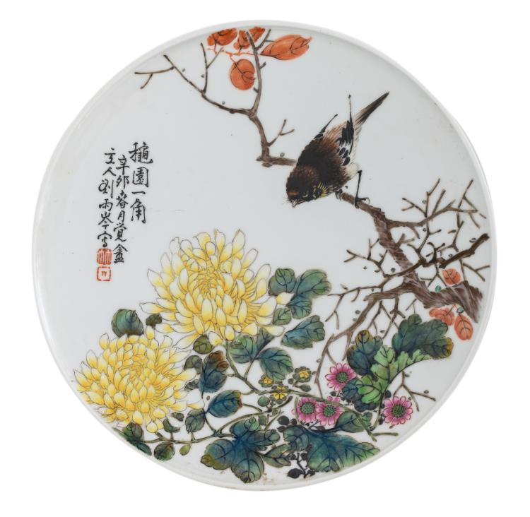 A Chinese famille rose dish, decorated with a bird and flower branches, signed by the artist, ø 24,5 cm