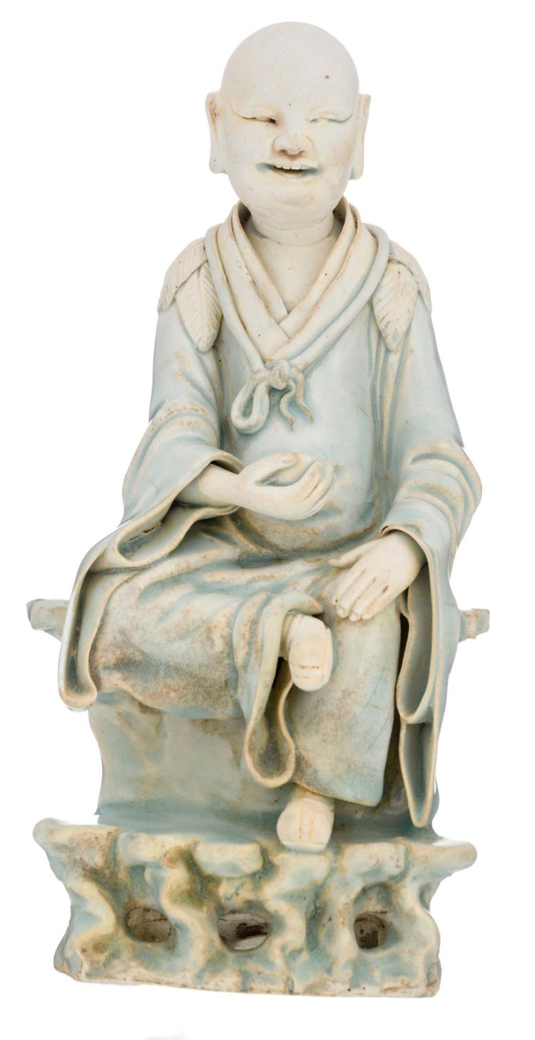 A Chinese glazed biscuit figure depicting a Lohan monk, H 21 cm