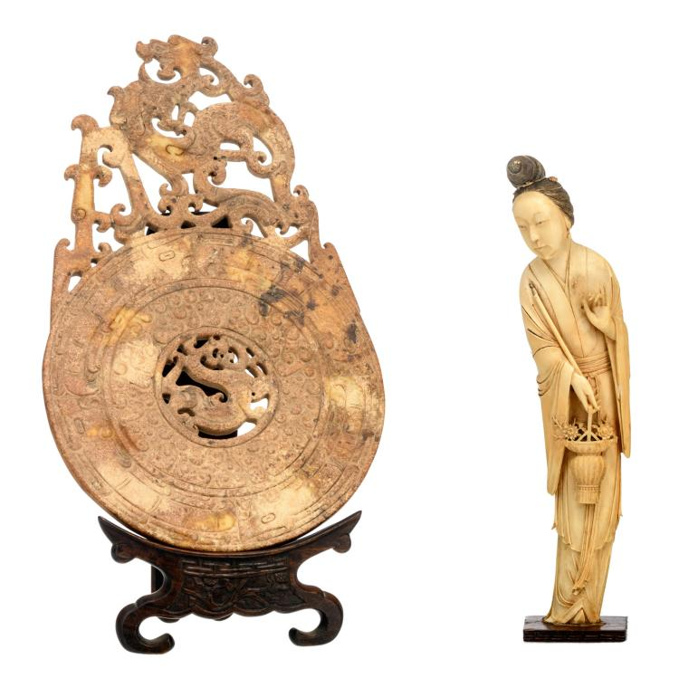 A Chinese ivory beauty with engraved decoration, on a matching wooden base, about 1900; added a Chinese carved archaic dragon decorated bi disc, on a matching wooden stand, H 29 - 34 - W 21 cm - Weight of the beauty: about 605g