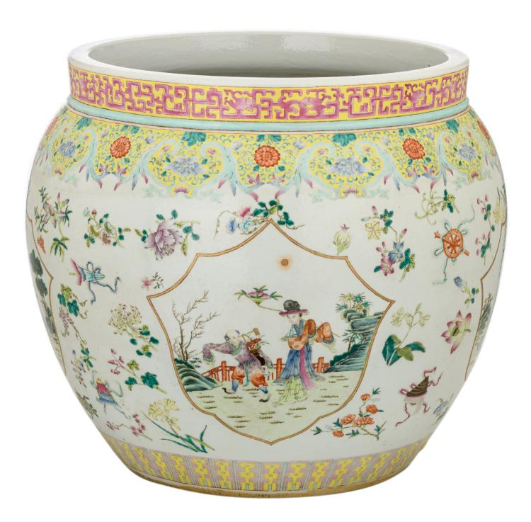 A Chinese famille rose overall floral decorated jardiniere with auspicious symbols, the roundels with various figures in a garden, H 48 - ø 46 cm