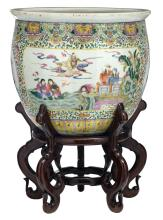 A Chinese famille rose overall floral decorated fish bowl with auspicious symbols, the roundels with flower branches and Immortals in their habitat, on a matching wooden stand, H 47 (without stand) - 73,5 (with stand) - ø 53 cm