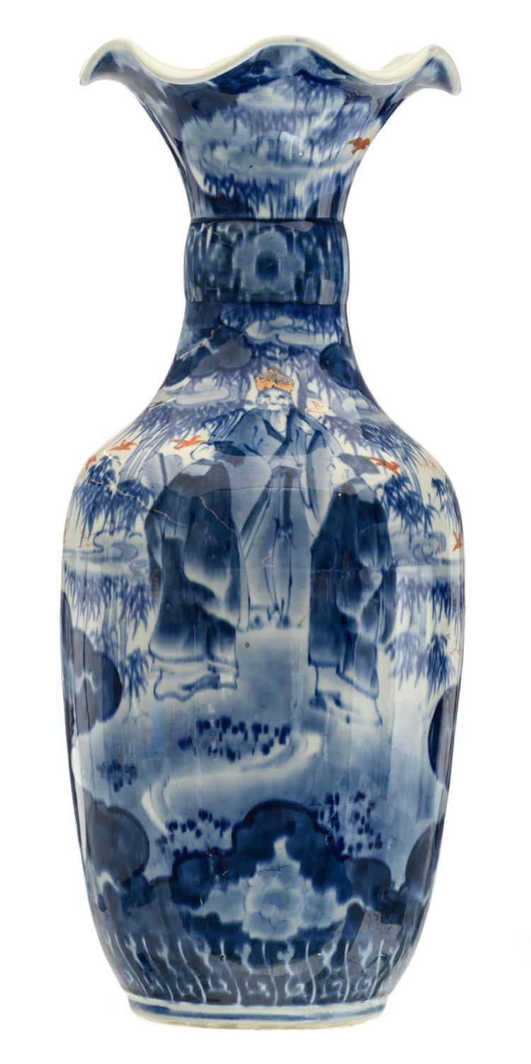A Japanese blue and white, iron red and gilt decorated vase with savants and birds in a landscape, H 55,5 cm
