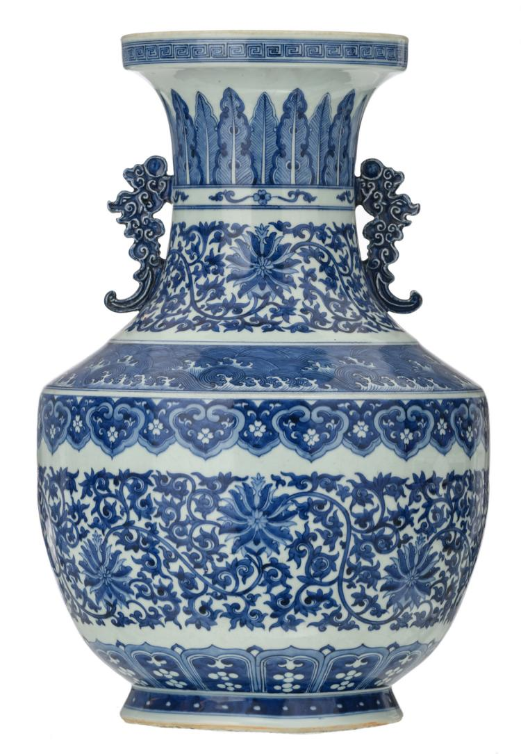 A Chinese blue and white floral decorated vase with lotus, the handles dragon shaped, H 53 cm