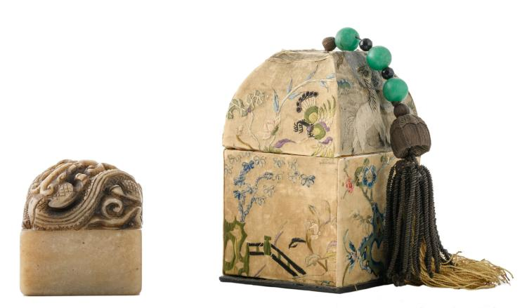 A Chinese carved dragon decorated stone seal in a matching silk embroidery upholstered box, H 7,5 (seal) - 15 cm (box)