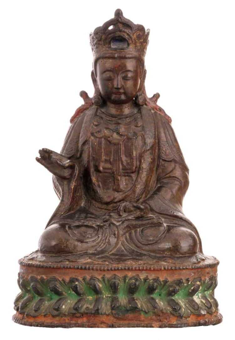 A Chinese seated bronze Buddha with traces of gilt lacquer and polychromy, Ming, H 29,5 cm